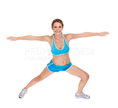 Buy stock photo A fit young woman doing stretches while isolated on a white background
