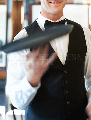 Buy stock photo Waiter spinning a serving tray on his fingers in a restaurant