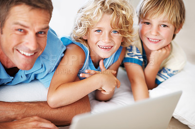Buy stock photo Portrait of smiling man using laptop at home with cute boys