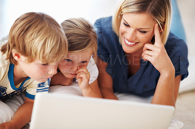 Buy stock photo Closeup of beautiful woman using laptop at home with cute sons