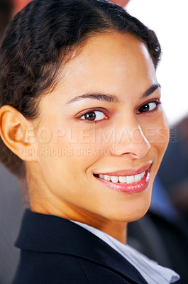 Buy stock photo Closeup of a young business woman smiling smartly at you