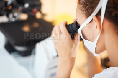 Buy stock photo Closeup portrait of female researcher using microscope in laboratory