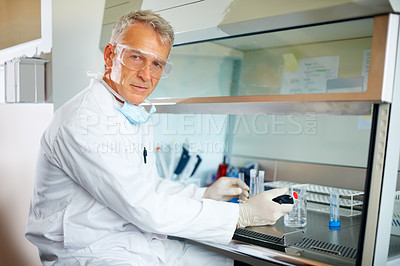 Buy stock photo Confident male scientist conducting chemical experiment at the lab
