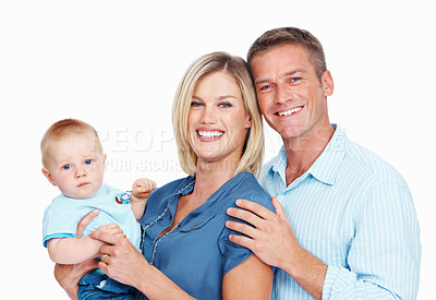 Buy stock photo Portrait of a happy couple posing with their cute baby