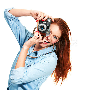 Buy stock photo Portrait of an attractive redhead taking a picture of you while isolated on white