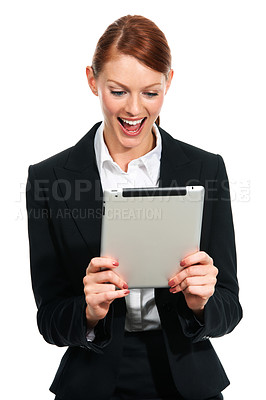 Buy stock photo A young executive finding something pleasing on her digital tablet