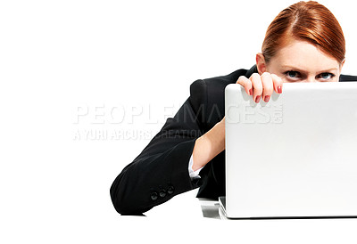 Buy stock photo Portrait of a young executive peering over her laptop