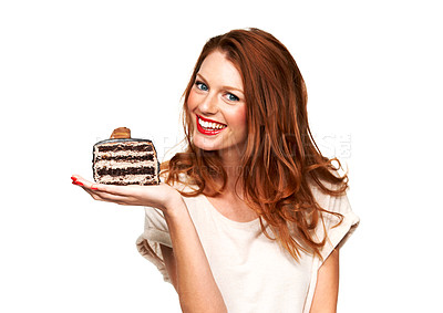 Buy stock photo Portrait of a young woman holding up a delicious piece of cake