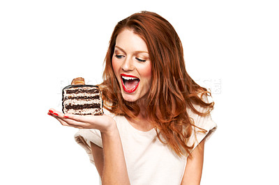 Buy stock photo A young woman about to take a giant bite of cake