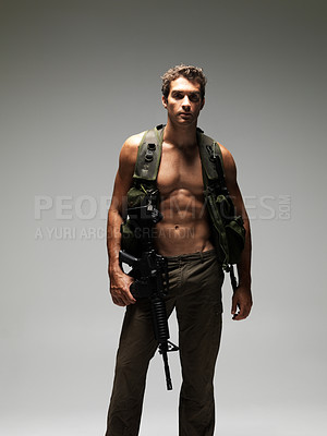 Buy stock photo Hunky soldier with a bare chest holding a M16 rifle and looking at the camera
