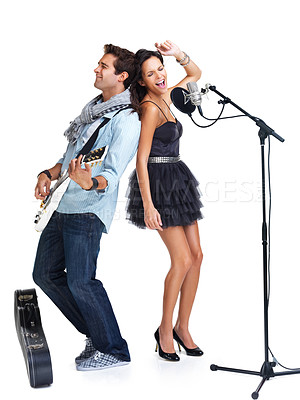 Buy stock photo Female singer and a male guitarist standing back to back while passionately performing a song - isolated