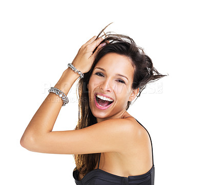 Buy stock photo Ecstatic young woman wearing two bracelets laughing at the camera while touching her hair