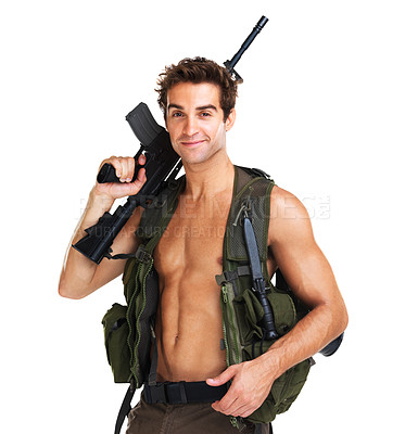 Buy stock photo Handsome young soldier with a bare chest holding an M16 rifle over his shoulder while smiling at the camera