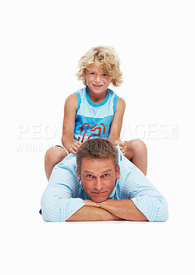 Buy stock photo Portrait of a cute little boy enjoying time with his father over white background
