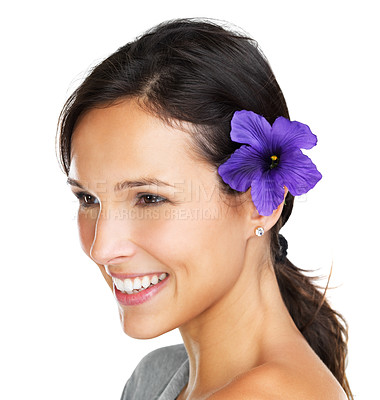 Buy stock photo Lovely brunette with a purple hibiscus flower behind her ear glancing out of the frame