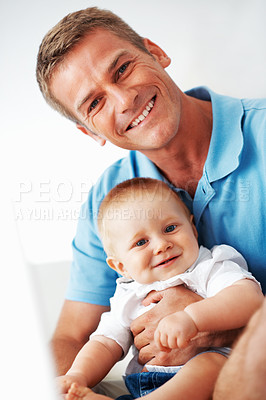 Buy stock photo Portrait of smiling handsome man holding cute baby boy at home