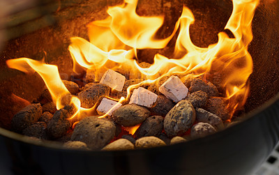 Buy stock photo Closeup of a warm fire burning in a barbeque