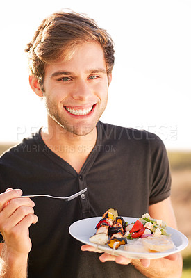 Buy stock photo Portrait of young man sitting and enjoying his meal