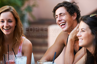 Buy stock photo Group of teens enjoying milkshakes and beverages while at an outdoor restaurant