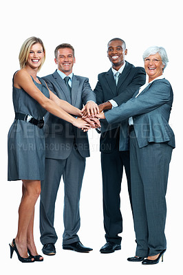 Buy stock photo Full length of enthusiastic business group with hands together showing unity on white background