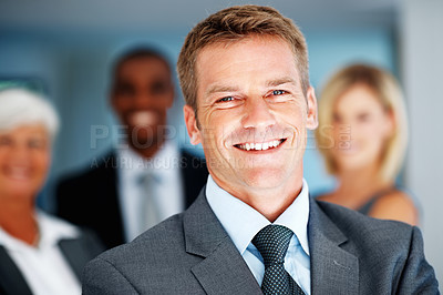 Buy stock photo Closeup of smiling business man with multi ethnic team in background