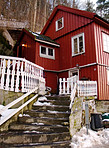 Red home in the snow - Winter Lodgings