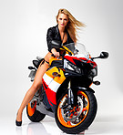 Sexy biker-babe revving her engine