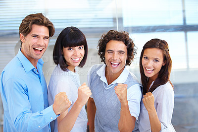 Buy stock photo A group of executives cheering together