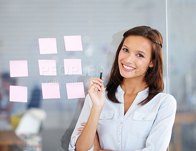 Buy stock photo A beautiful businesswoman delegating roles