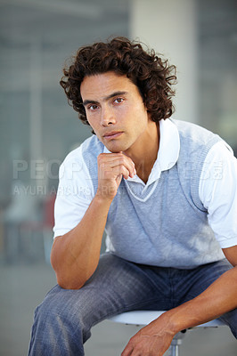 Buy stock photo A serious entrepreneur looking thoughtful