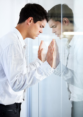 Buy stock photo A young businessman pushing his head against a glass door expressing negativity