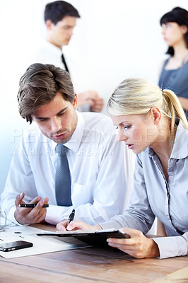 Buy stock photo Business colleagues working together on a company presentation and proposal