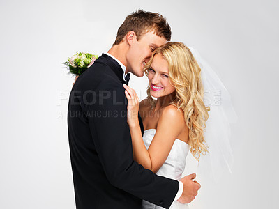Buy stock photo Cute newlywed couple embracing