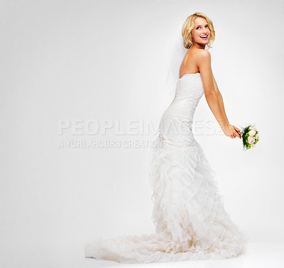 Buy stock photo Attractive young bride getting ready to throw her bouquet