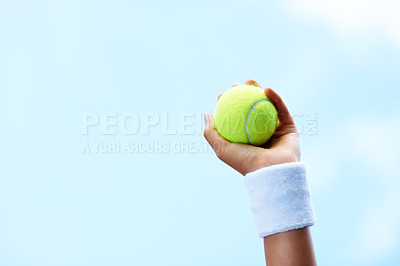 Buy stock photo Cropped view of a tennis player holding the ball up in the air