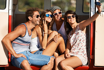 Buy stock photo Four close friends pose for a self-portrait while sitting in their van