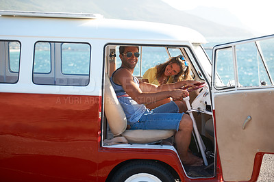 Buy stock photo Young couple stopping to see the sights on their coastal road trip