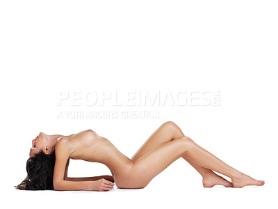 Buy stock photo Studio shot of a young sexy nude woman lying with her back arched against a white background