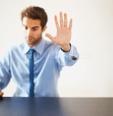 Buy stock photo Young executive with open hand making stop