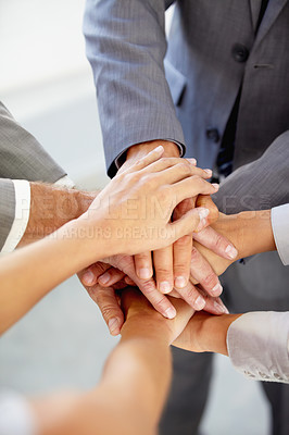 Buy stock photo Cropped view of businesspeople's hands indicating unity