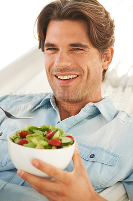 Buy stock photo Portrait of a healthy young man eating a bowl of salad