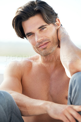 Buy stock photo Portrait of a rugged young man sitting and looking at the camera