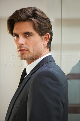 Buy stock photo Portrait of a handsome businessman at the office