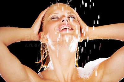 Buy stock photo Lovely young woman having a refreshing shower while isolated on black