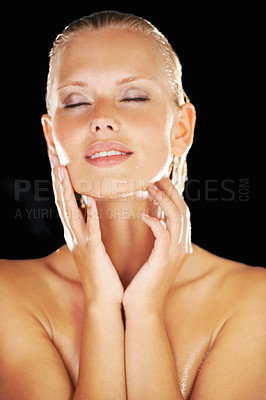 Buy stock photo Calm young woman caresses her skin after her shower
