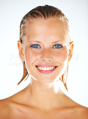 Buy stock photo Closeup portrait of a happy young woman with gorgeous blue eyes and a perfect set of teeth