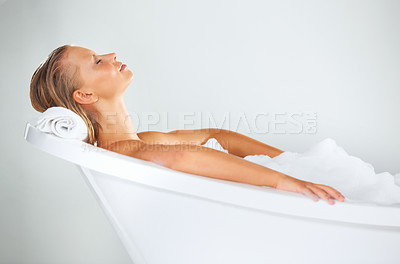 Buy stock photo Pretty young woman unwinding as she relaxes in her bath