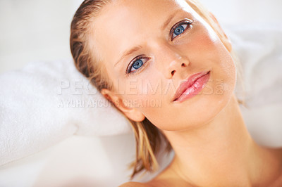 Buy stock photo Portrait of a beautiful young woman looking at you while relaxing