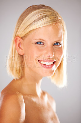 Buy stock photo Gorgeous young woman with blond hair giving you a big smile - Closeup