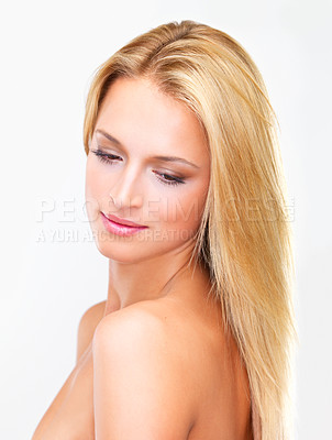 Buy stock photo Naturally beautiful blonde woman with flawless skin gazing away dreamily, isolated on white